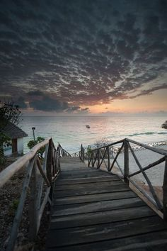 Daybreak comes slowly to a secluded beach on the Tanzanian island of Zanzibar, off Africa's Swahili Coast. White, sandy beaches and fringing coral reefs lure sunseekers away from the beaten path....