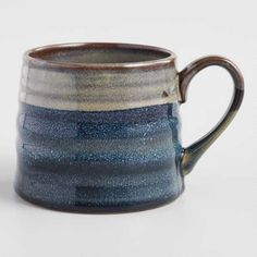 Enliven your kitchen essentials with our one-of-a-kind textured mugs. Offering unique artisanal appeal with every sip, their amply-sized silhouette features a color block design of gray and indigo blue that extends to the handle. Stoneware Mugs, Ceramic Cups, Earthenware, Ceramic Art, Pottery Designs, Mug Designs, Pottery Mugs, Ceramic Pottery, Blue Pottery