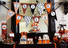 I love this cute dessert table! Great alternative to the creepy Halloween decor.