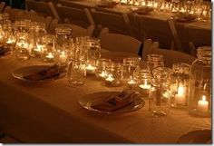 Mason Jar centerpieces. With different height candles so that as the night went on it would get dimmer and dimmer <3