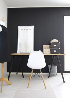 eames chair but with a charcoal grey wall instead of black