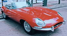The Jaguar E-Type is a classic sports car. Its from the It& top speed is 150 mph. It is a great car! It is available in hardtop, soft-top and convertible. Its the best Jaguar ever made. Its very old but not the oldest Jaguar ever made. Jaguar Roadster, Jaguar Cars, Jaguar Models, Jaguar Xk, Jaguar Xj220, Best Classic Cars, Classic Sports Cars, Jaguar E Type 1961, Aston Martin
