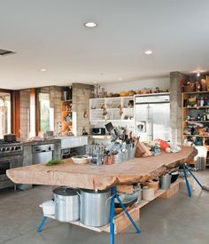 A massive slab of cypress perched atop sawhorses provides storage for pots and utensils.  Photo by Dave Lauridsen.
