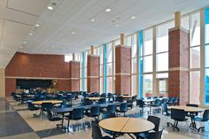 A number of dynamic community spaces including the cafeteria, gymnasium, and auditorium are centrally located near the building entrance to facilitate after-hours use by the public. Cafeteria Design, Liberty High School, Dream School, Community Space, Home Theater Rooms, Imagines, Private School, Wattpad, Architecture