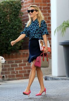 Actress and busy mom Reese Witherspoon and her husband Jim Toth seen leaving her office in Beverly Hills, California on August 26, 2016. It was recently announced that Reese with be teaming up with Nicole Kidman to produce a limited series version of the novel 'Truly Madly Guilty' for HBO.