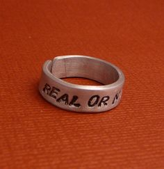 Hunger Games Inspired  'Real Or Not Real'. wedding band? haha i think scott would kill me