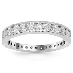 This exquisite womens diamond eternity band is crafted in lustrous 14K white gold. The frame is channel set with brilliant round cut diamonds which are VS in clarity and G in color. The band weighs approximately 3.5 grams and measures to 1/8 Inches. This finely detailed womens diamond eternity band is an ideal gift for that special someone. $3,025.00