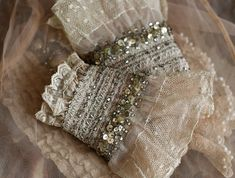 wrist wraps with antique lace and vintage sequins