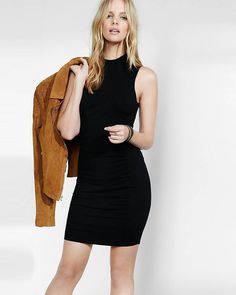 This mock neck sweater dress has side ruching that calls out all of your curves…