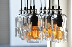 The Apothecary, recycled bottle chandelier made with 10 Boston Round bottles and antique style Radio Tube bulbs.