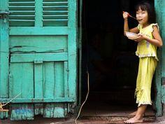 Ho Chi Minh City - young girl enjoying pho