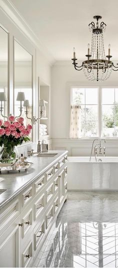 Elegant, Traditional White Bathroom. I would change the pulls and install shutters on the window.