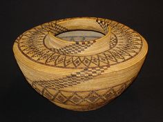 A Yokuts bottleneck basket by Aidaicho Wahnomkot, Wukchumne Yokuts from the Kaweah River, c.1925 Diameter:10in x Height: 6in