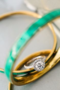A gorgeous engagement ring from Greenlake Jewelry in Seattle.  The ring is nestled withing malachite bangles that the bride's mother-in-law gifted her before their engagement.  Alante Photography See more here: http://www.alantephotography.com