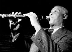 Sidney Bechet (1897 – 1959) was an American jazz saxophonist, clarinetist, and composer. He was one of the first important soloists in jazz (beating cornetist and trumpeter Louis Armstrong to the recording studio by several months[1] and later playing duets with Armstrong), and was perhaps the first notable jazz saxophonist. Forceful delivery, well-constructed improvisations, and a distinctive, wide vibrato characterized Bechet's playing.