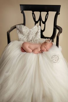 My sweet girl on her mama's gown