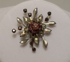1960 Silver w/Amethyst Colored Stones and a leaf pattern pinwheel design 1.5 inches SOLD