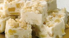 These piña colada fudge squares are the perfect dessert to serve at a party. Check out this riot of flavors packed with dried pineapple, coconut, rum and macadamia nuts.