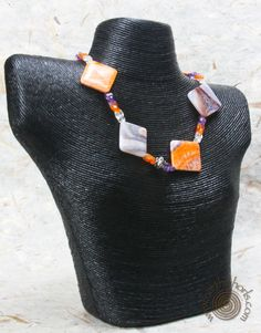 http://earthwhorls.com/product/amethyst-fire-agate-hill-tribe-silver-necklace/  Nature understands drama!