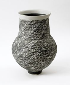 Julian Stair. Porcelain vase with sgraffito decoration in gray slip over white body, unglazed. Via www.freeformsusa.com