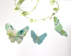 Nursery Mobile - Butterfly Ballet - handmade fabric mobile for nursery decor in mint green, aquamarine, turquoise and white. $98.00, via Etsy.