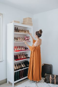shoe storage solutions made pretty  Photography : Emmy Lowe Read More on SMP: http://www.stylemepretty.com/living/2016/11/22/peek-inside-the-dream-closet-turned-office-of-a-fashion-blogger/