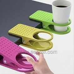 Now I can either hold a drink at the drawing table or us it for my water cup for watercolor..... Should keep the cats from knocking liquids onto my paintngs![US$8.54] Creative Universal Cup Holder Clip Gift