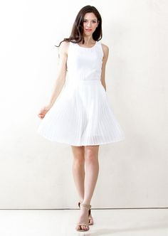 Pleat Nothing Dress. White sleeveless dress with a pleated skirt. Zipper closure on back. #fashion #dresses #pleated