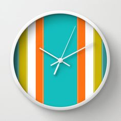 Turquoise Orange and Yellow Wall Clock.  Diameter size: 10 Depth: 1,75    This unique Wall Clock features a high-impact Plexiglas crystal face