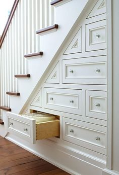 Drawers under the stairs, great alternative to a closet, especially for the lower spaces.