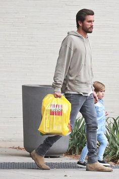 Scott Disick wearing John Elliott Kake Mock Pullover, Saint Laurent Original Low Waisted Skinny Jean in Washed Grey Stretch Denim and Common Projects Suede Chelsea Boots