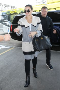 Demi Lovato wearing  Alexander Wang Gabi Boots, Vince Colorblock Wool/Cashmere Car Coat, Hermès Birkin Bag Black Gold Hardwear