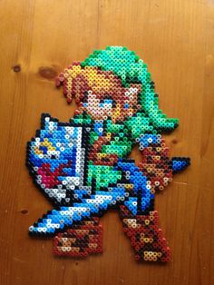 Link needs you! Only with your aid (*cough* and purchase) can he be released from my PerlerBead prison so that he can successfully rescue