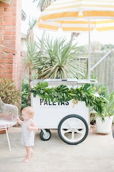 Vine-covered cart from a Jungle 1st Birthday Party on Kara's Party Ideas | KarasPartyIdeas.com (17)