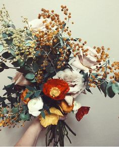 I love the 'feel' of this bouquet!  It has a wildness and a delicateness and a nice balance of 'pop' in the color with texture.  It looks a little too tall and the color isn't quite right (too autumnal).