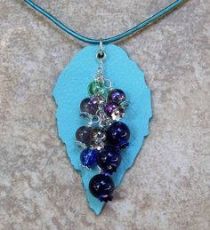 Terry ricioli designs grape cluster pendant jewelry for Terry pool design jewelry