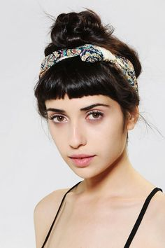 Cute floral bandana with dangerously short bangs.