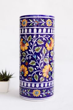 Description: Give your flowers and plants a new and beautiful home with this handpainted cylindrical vase!Design: Part of the Iranian tradition of cobalt blue pottery, this clay vase will make for an alluring addition to your home decor. Pottery Painting Designs, Pottery Designs, Paint Designs, Blue Pottery Jaipur, Pichwai Paintings, Pottery Patterns, Persian Motifs, Clay Vase, Painted Jars