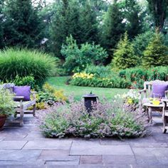 .love everything here..blue stone, catmint, trees staggered, etc