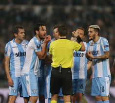 Marco Parolo with his teammates of SS Lazio reacts against the referee Ovidiu Hategan during the UEFA Europa League quarter final leg one match between SS Lazio and RB Salzburg at Stadio Olimpico on April 5, 2018 in Rome, Italy. - 57 of 120
