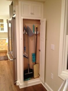 """Broom Cabinet next to fridge our pantry which is 14"""" deep. It opens to the side. It was hard to get all of it in one pic due to a tight space. I hope these pictures help..."""