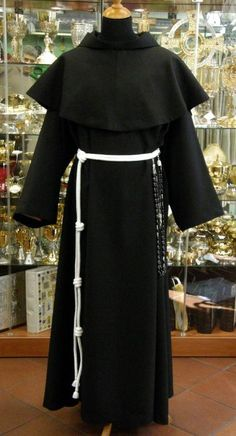 Black Franciscan habit. The three knots in the belt remind the wearer of the vows of poverty, chastity, and obedience.