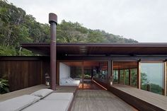 Large wooden deck and open living space defines the lavish Sao Paulo house