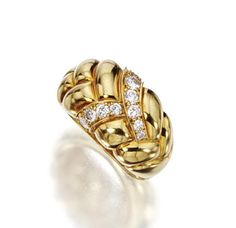 18 KARAT GOLD AND DIAMOND RING, VAN CLEEF & ARPELS, NEW YORK.    The polished gold band with braided front set with 10 round diamonds, size 5¾, signed VCA, made in France, numbered NY 5K691-2.