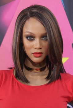 Tyra Banks sleek sexy shoulder length hairstyle