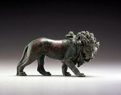 Roman Bronze Lion with Eyes Inlaid in Silver    		Bronze and silver, 1st century…