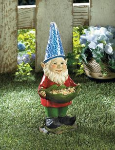 Bird feeder garden gnome solar statue.  Give the birds a snack in the daylight and your garden some glow at night with this charming gnome.  He holds a leaf that you can fill with bird feed and the built-in solar panel will light up his blue hat after the sun sets
