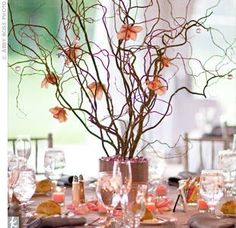 we'll be adding flowers to the curly willow centerpieces, just like these :) except ours will be aqua blue