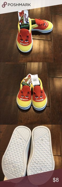Zootopia slip-on sneakers - sz 8 toddler - NWT These super cute slip-ons are brand spanking new, because, even though I thought my 2 yr old daughter would love the silly faces on the front, she copped an attitude about it and threw the shoes across the room! No second chances for the tantrum! Would love for a little kiddo to appreciate them and wear them like it's their job  No trades! Offers always considered! Questions? Ask away! Disney Shoes Sneakers