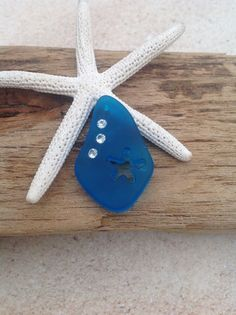 NEW-drilled starfish cut out sea glass pendant.  We have some beautiful new items. This is a great new turquoise bay blue color freeform cultured sea glass pendant with a dainty carved star and accented with 3 crystal. The possibilities are endless. Wire wrap, add a chain, but 2 and make earrings or add to a charm bracelet. We also have Cobalt Blue, light Aqua coke bottle  and periwinkle. Check out our sea glass bead category from our home page.  Other shapes carved that we carry in multiple…
